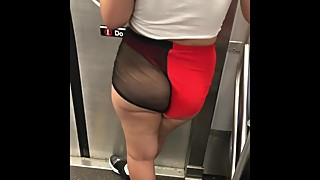 Wife in mesh see through shorts walking around train station