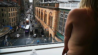 my wife at hotel window naked