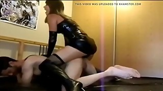 Wife in leather dress and leather boots fuck with strapon at husband