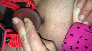 Wife fucking her pussy with strap on