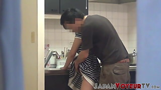 Voyeur films Japanese housewife fucked in the kitchen