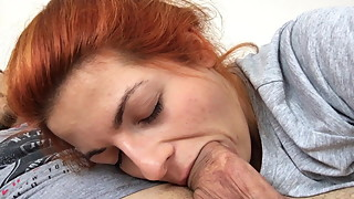 my redhead gf sucks while iam watching tv